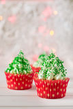 Christmas cupcakes with christmas tree shape, sparkler and lights Stock Photo