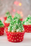 Christmas cupcakes with christmas tree shape, sparkler and lights Royalty Free Stock Photos