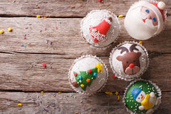 Christmas cupcakes closeup on a wooden table. Horizontal top vie Royalty Free Stock Image