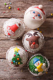 Christmas cupcakes closeup on a wooden table. vertical top view Royalty Free Stock Photo