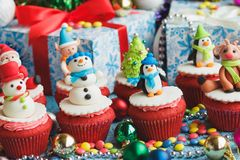 Christmas cupcakes with colored decorations. Made from confectionery mastic, soft focus background Royalty Free Stock Photography