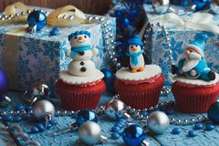 Christmas cupcakes with colored decorations. Made from confectionery mastic, soft focus background Stock Image