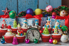 Christmas cupcakes with colored decorations Royalty Free Stock Photos