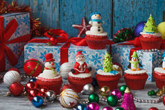 Christmas cupcakes with colored decorations Stock Images