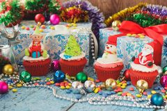 Christmas cupcakes with colored decorations made from confectionery mastic. Soft focus background Stock Photo