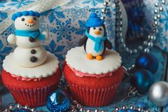 Christmas cupcakes with colored decorations made from confectionery mastic. Soft focus background Royalty Free Stock Photo