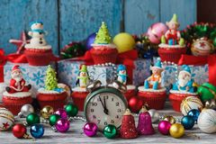 Christmas cupcakes with colored decorations made from confectionery mastic. Soft focus background Royalty Free Stock Photos