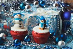 Christmas cupcakes with colored decorations made from confectionery mastic. Soft focus background Stock Images