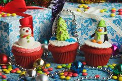 Christmas cupcakes with colored decorations. Made from confectionery mastic, soft focus background Stock Photo