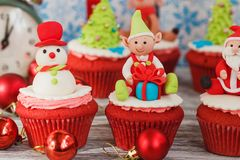 Christmas cupcakes with colored decorations, soft focus background. Christmas cupcakes with colored decorations made from confectionery mastic, soft focus Royalty Free Stock Images