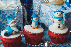 Christmas cupcakes with colored decorations Stock Photography