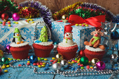 Christmas cupcakes with colored decorations Stock Photos