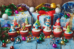 Christmas cupcakes with colored decorations Stock Image