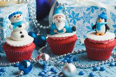 Christmas cupcakes with colored decorations. Made from confectionery mastic, soft focus background Royalty Free Stock Photos