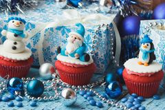 Christmas cupcakes with colored decorations made from confectionery mastic. Soft focus background Royalty Free Stock Image