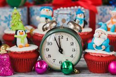 Christmas cupcakes with colored decorations. Made from confectionery mastic, soft focus background Stock Photos