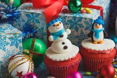 Christmas cupcakes with colored decorations. Made from confectionery mastic, soft focus background Stock Images