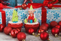 Christmas cupcakes with colored decorations, soft focus background. Christmas cupcakes with colored decorations made from confectionery mastic, soft focus Royalty Free Stock Photo