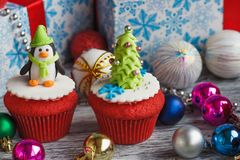 Christmas cupcakes with colored decorations, soft focus background. Christmas cupcakes with colored decorations made from confectionery mastic, soft focus Stock Photo