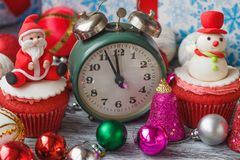 Christmas cupcakes with colored decorations, soft focus background. Christmas cupcakes with colored decorations made from confectionery mastic, soft focus Royalty Free Stock Image