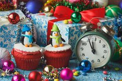 Christmas cupcakes with colored decorations penguin made from confectionery mastic. Soft focus background Royalty Free Stock Image