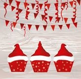 Christmas cupcakes with cream in the form of a Santa Claus hat. Garland with flags and confetti. Greeting card or invitation for the New Year holiday. Vector stock illustration