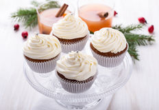 Christmas cupcakes with creamcheese frosting. Homemade christmas cupcakes with creamcheese frosting on cake stand on light background for holiday treat royalty free stock images