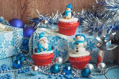 Christmas cupcakes with decorations made from confectionery mast. Ic, soft focus background Stock Photography