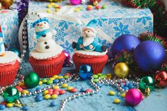Christmas cupcakes with decorations made from confectionery mastic. Soft focus background Royalty Free Stock Photography