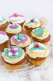 Christmas cupcakes in festive setting stock image