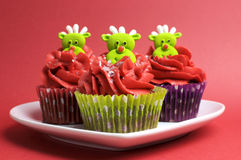 Christmas cupcakes with fun and quirky reindeer faces Royalty Free Stock Images