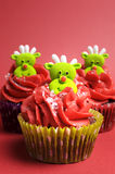 Christmas cupcakes with fun and quirky reindeer faces - vertical. Royalty Free Stock Photography