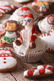 Christmas cupcakes and gingerbread macro on a wooden table. Vert Stock Photos