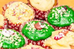 Christmas cupcakes with green and yellow icing Royalty Free Stock Images