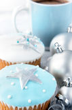 Christmas cupcakes with hot beverage Stock Photos