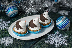 Christmas cupcakes in the shape of funny penguins Royalty Free Stock Photo