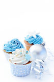 Christmas cupcakes with silver ornaments. Blue icing frosted cup cake with silver christmas ornaments and decorations, plenty of copyspace Stock Images