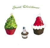 Christmas Cupcakes sketch on white. Christmas Cupcake Hand Drawn sketch.  on white Royalty Free Stock Photo