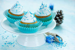 Christmas cupcakes on stand on blue background Royalty Free Stock Images