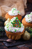 Christmas cupcakes with whipped cream Royalty Free Stock Photos