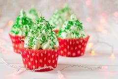 Free Christmas Cupcakes With Christmas Tree Shape, Sparkler And Lights Stock Photo - 81988380