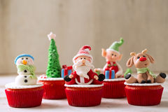Christmas cupcakes. On wood background Royalty Free Stock Image