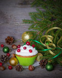 Christmas cupcakes on a wooden background. Stock Photos