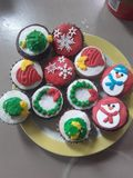 Christmas Cupcakes on a yellow and white plate stock images