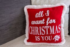 Christmas cushion decorating a sofa during the holidays royalty free stock images