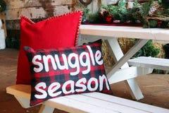 Christmas cushion that say snuggle season stock photo