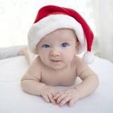 Christmas cute baby boy lying on white soft plaid Stock Photography