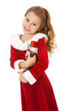 Christmas: Cute Girl With Nutcracker Doll Stock Images