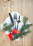 Christmas cutlery and fir tree on wooden background Stock Images