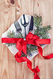 Christmas cutlery and fir tree on wooden background Royalty Free Stock Image